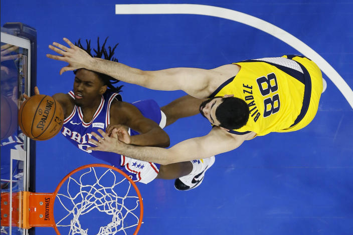 Philadelphia 76ers' Tyrese Maxey, left, goes up for a shot against Indiana Pacers' Goga Bitadze during the first half of an NBA basketball game, Monday, March 1, 2021, in Philadelphia. (AP Photo/Matt Slocum)