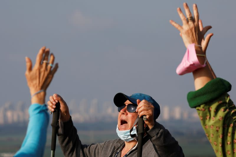To lift lockdown gloom, Israelis keep calm and carry on screaming