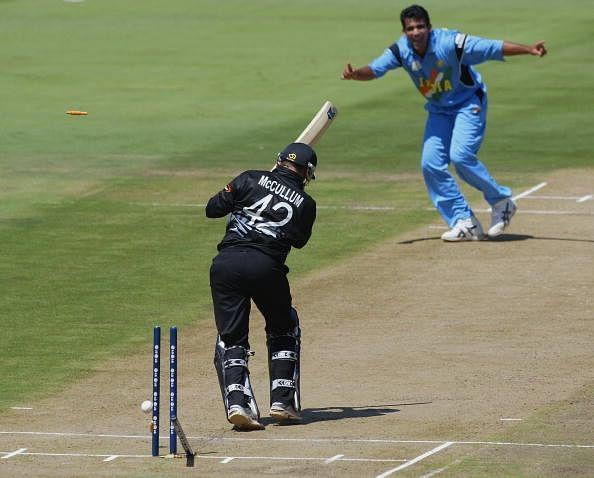 Brendon McCullum of New Zealand is bowled out by Zaheer Khan of India