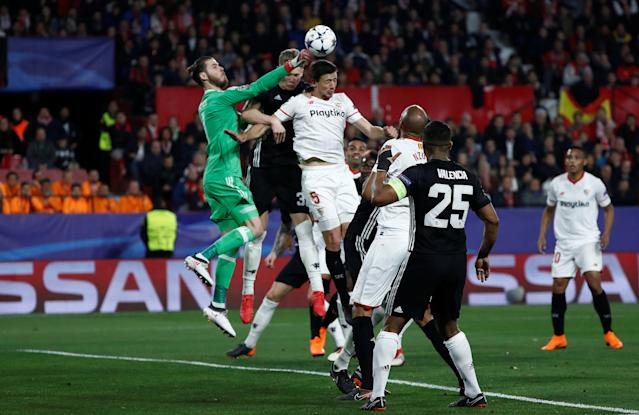 Soccer Football - Champions League Round of 16 First Leg - Sevilla vs Manchester United - Ramon Sanchez Pizjuan, Seville, Spain - February 21, 2018 Manchester United's David De Gea punches the ball away from Sevilla's Clement Lenglet REUTERS/Juan Medina