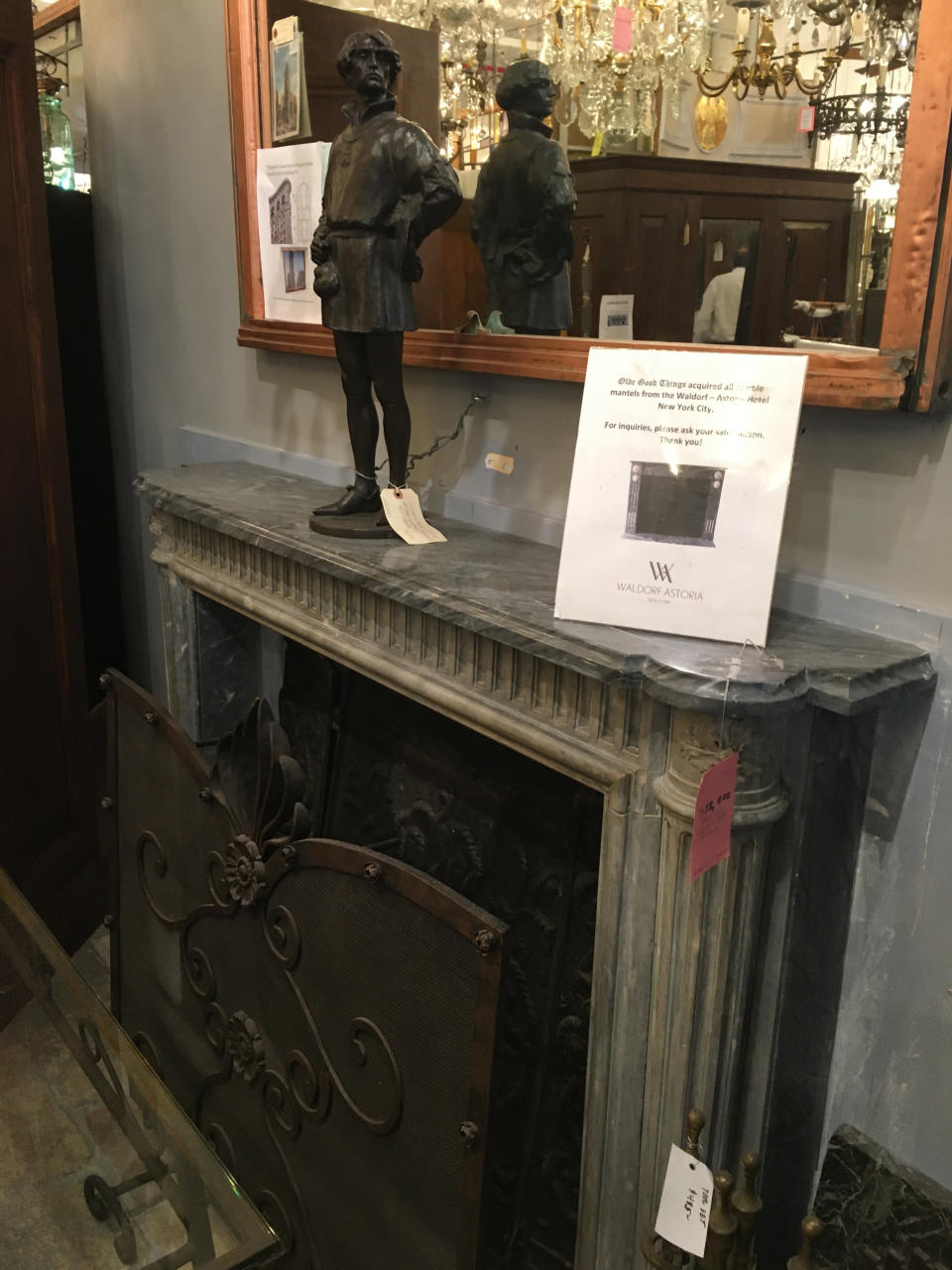 """This Oct. 15, 2019 photo shows a fireplace mantel salvaged from the Waldorf-Astoria hotel, among other items available for sale at Olde Good Things salvage store in New York. Two of the hottest trends in home decor are sustainability and authenticity. """"It's about both history and sustainability,"""" says Madeline Beauchamp of Olde Good Things, one of the oldest architectural salvage businesses in the country, with one shop in Los Angeles, another in Scranton, Pennsylvania, two stores in New York, and a flagship store to open soon in Midtown Manhattan. (Katherine Roth via AP)"""