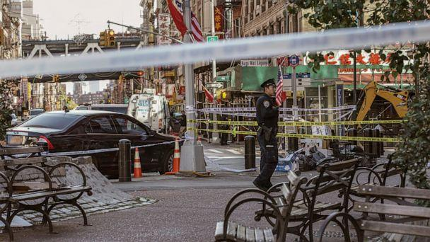 PHOTO: New York Police Department officers investigate the scene of an attack in Manhattan's Chinatown neighborhood, Oct. 5, 2019, in New York. (Jeenah Moon/AP)