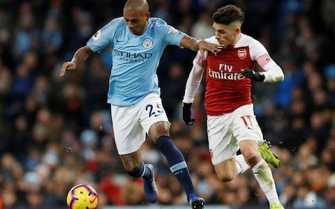 Manchester City's Fernandinho in action with Arsenal's Lucas Torreira - Credit: REUTERS
