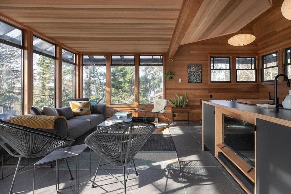 """<strong>Bedrooms:</strong> 3<br> <strong>Bathrooms:</strong> 2<br> <strong>Minimum stay:</strong> 2 nights<br> <br> Stay in a wooded retreat with all the modern amenities you could want. Lovely details are found throughout this beach home, like the red cedar walls and bridge walkway that leads to the front door. With tall trees all around and a three-story, modular layout, it's the closest thing to staying in a treehouse you'll find. $450, Airbnb (Starting Price). <a href=""""https://www.airbnb.com/rooms/plus/28564523"""" rel=""""nofollow noopener"""" target=""""_blank"""" data-ylk=""""slk:Get it now!"""" class=""""link rapid-noclick-resp"""">Get it now!</a>"""
