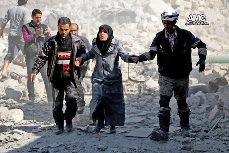 This photo provided by the anti-government activist group Aleppo Media Center (AMC), which has been authenticated based on its contents and other AP reporting, shows Syrian men helping a survivor out of a destroyed building after a Syrian forces warplanes attacked Masaken Hanano neighborhood, in Aleppo, Syria, Monday, Feb. 17, 2014. The Western-backed Free Syrian Army has appointed a new military chief, opposition groups announced Monday as they try to restructure a rebel movement that has fallen into disarray as it faces rampant infighting and declining international support for its fight to topple President Bashar Assad. (AP Photo/Aleppo Media Center, AMC)