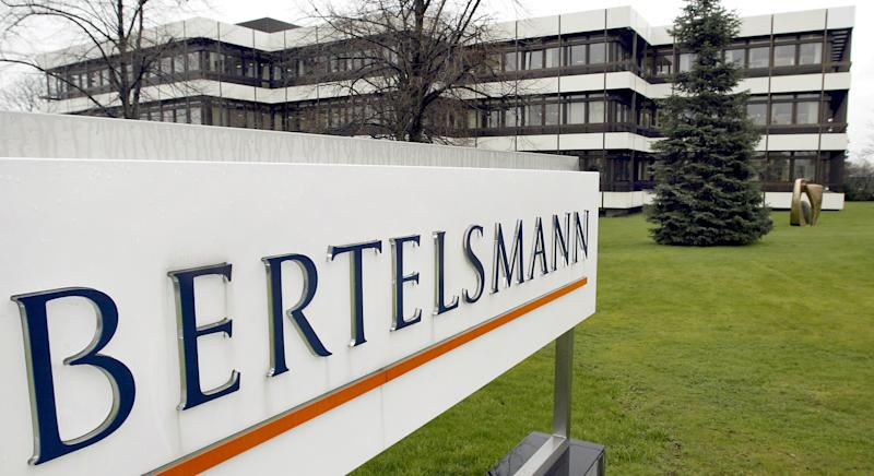FILE - This March 13, 2003 file photo shows an outside view of the German media giant Bertelsmann in Guetersloh, Germany. Parent companies Bertelsmann and Pearson announced Monday, June 3, 2013, that the merger between Random House Inc. and Penguin Group has been cleared by anti-trust authorities in China, among the last countries to give approval. The new publishing house, Penguin Random House, will be 53 percent controlled by Bertelsmann and 47 percent by Pearson.  (AP Photo/Michael Sohn, File)