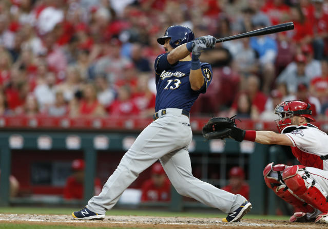 Milwaukee Brewers' Tyler Saladino (13) singles off Cincinnati Reds starting pitcher Sonny Gray during the fifth inning of a baseball game, Wednesday, July 3, 2019, in Cincinnati. (AP Photo/Gary Landers)