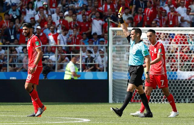 Soccer Football - World Cup - Group G - Belgium vs Tunisia - Spartak Stadium, Moscow, Russia - June 23, 2018 Tunisia's Ferjani Sassi is shown a yellow card by referee Jair Marrufo REUTERS/Grigory Dukor