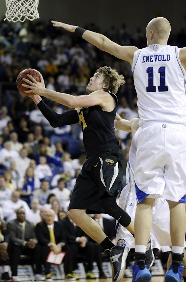 Wichita State guard Ron Baker, left, drives to the basket past Drake center Jacob Enevold, right, during the second half of an NCAA college basketball game, Saturday, Jan. 25, 2014, in Des Moines, Iowa. Wichita State won 78-61. (AP Photo/Charlie Neibergall)