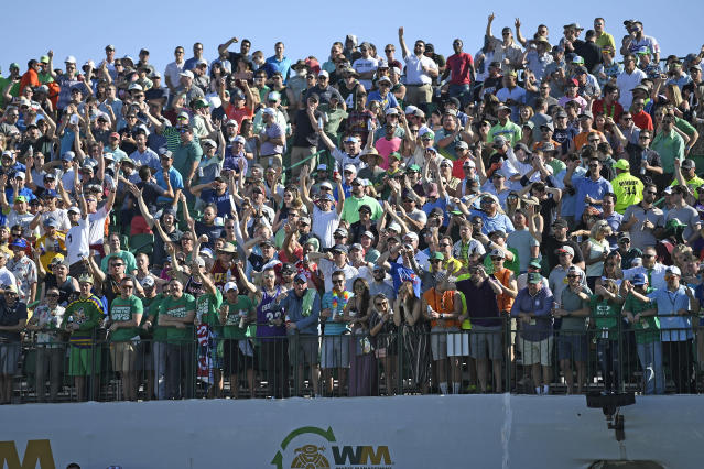 Imagine the 16th hole crowd at TPC Scottsdale during a Tiger vs. Phil one-on-one match. (Getty)