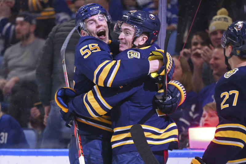 Buffalo Sabres forward Jimmy Vesey (13) celebrates his goal with defenseman Rasmus Ristolainen (55) during the third period of the team's NHL hockey game against Toronto Maple Leafs, Sunday, Feb. 16, 2020, in Buffalo, N.Y. (AP Photo/Jeffrey T. Barnes)