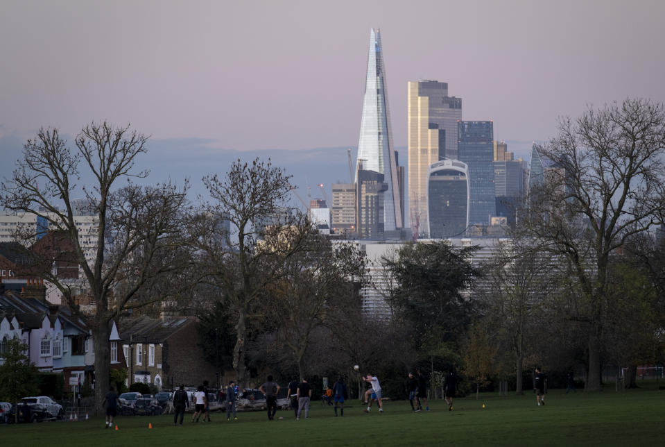 With the financial district of the City of London plus the Shard in the distance, local, football players kick a ball around in Ruskin Park, Herne Hill, on 19th November 2020, in Lambeth, London, England. (Photo by Richard Baker / In Pictures via Getty Images)