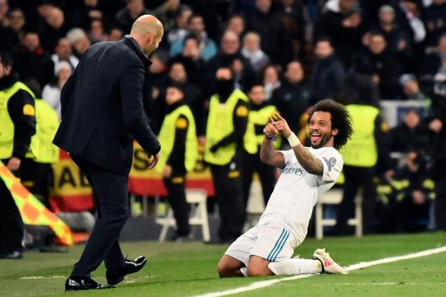 "<a class=""link rapid-noclick-resp"" href=""/soccer/players/marcelo/"" data-ylk=""slk:Marcelo"">Marcelo</a> celebrates his goal – <a class=""link rapid-noclick-resp"" href=""/soccer/teams/real-madrid/"" data-ylk=""slk:Real Madrid"">Real Madrid</a>'s third – against PSG on Wednesday at the Santiago Bernabeu. (Getty)"