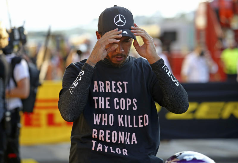 Mercedes driver Lewis Hamilton wore a Breonna Taylor shirt after winning the Tuscan Grand Prix, and now the FIA is investigating whether he broke any rules by doing so. (Bryn Lennon, Pool via AP)
