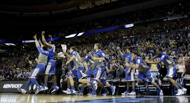 Kentucky players jump off the bench after winning a third-round game against Wichita State at the NCAA college basketball tournament Sunday, March 23, 2014, in St. Louis. Kentucky won the game 78-76. (AP Photo/Charlie Riedel)