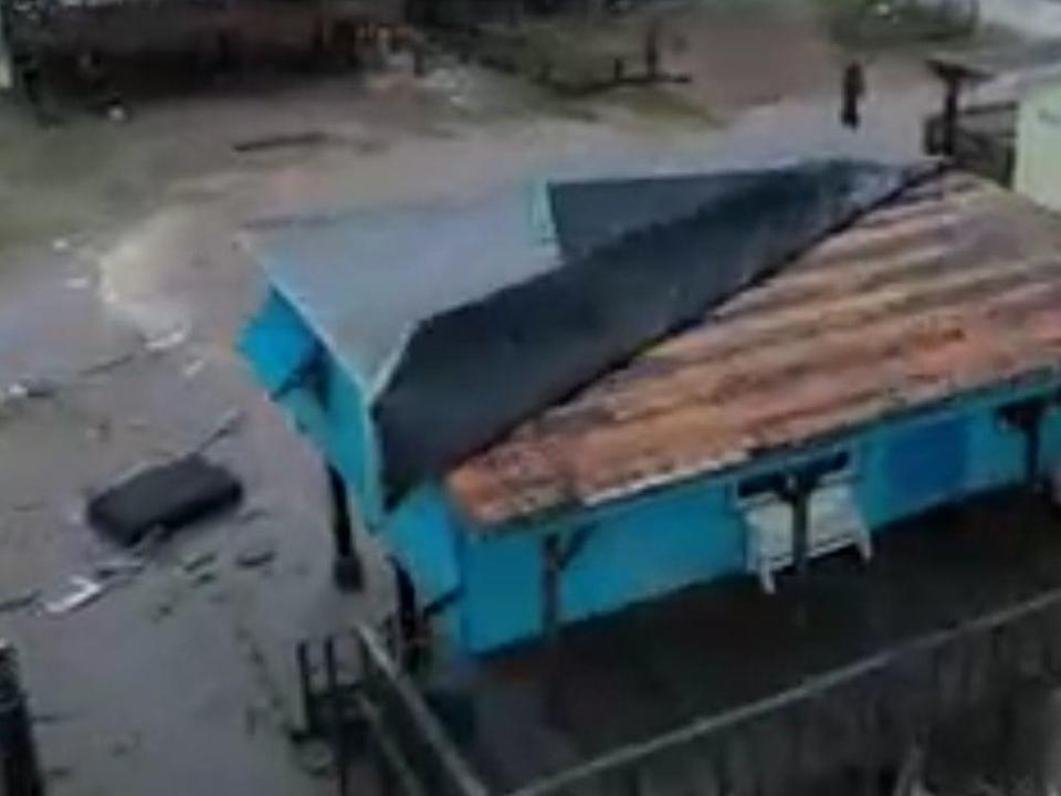 Footage showed houses with roofs blown off and flooding after storm Nicholas (TheWeatherChannel)