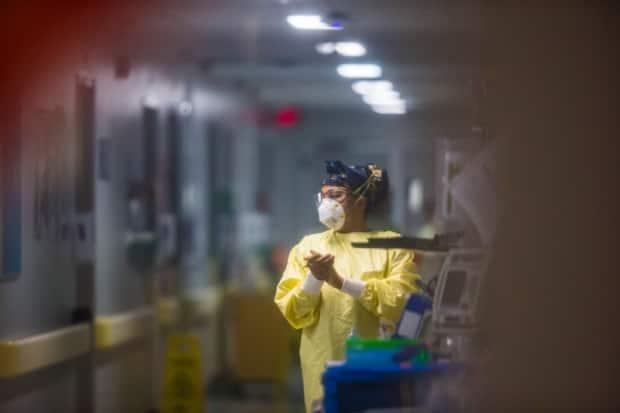 A surge in COVID-19 hospitalizations has disrupted non-pandemic-related health services in Manitoba, including how many surgeries are being performed, a spokesperson for Shared Health said. (Mikaela MacKenzie/The Canadian Press - image credit)
