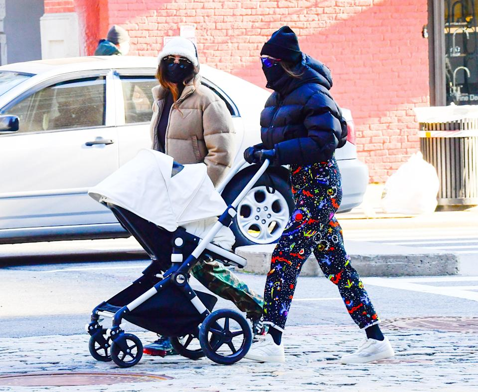 """Gigi ofter favors more tailored looks, even when she's running quick errands. This day, however, she opted for some out-there galaxy pants from Louis Vuitton – possibly to keep up with <a href=""""https://www.teenvogue.com/story/gigi-hadid-zayn-birthday-cozy-outfits?mbid=synd_yahoo_rss"""" rel=""""nofollow noopener"""" target=""""_blank"""" data-ylk=""""slk:Zayn's arcade-theme celebrations"""" class=""""link rapid-noclick-resp"""">Zayn's arcade-theme celebrations</a>, which took place the same day – and a cropped puffer jacket."""