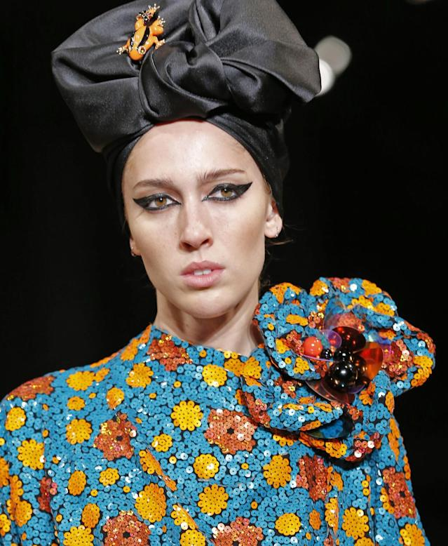 "<p>Models wore head wraps and scarves to ""get rid of hair."" (Photo: AP Images) </p>"