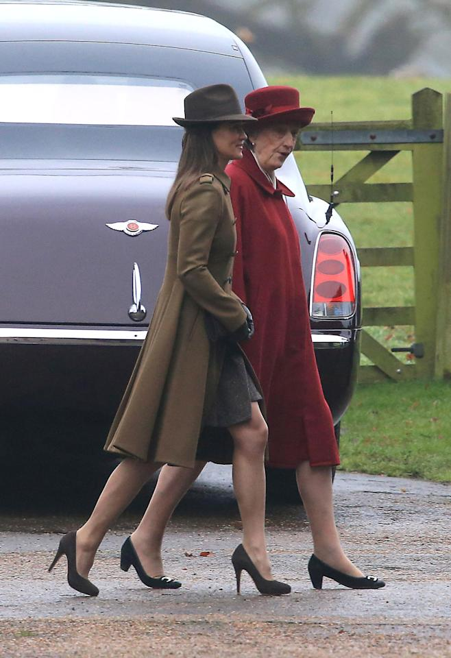 <p>Pippa went detective style, donning a brown coat and matching hat for a wintertime church service. <i>[Photo: Getty]</i></p>