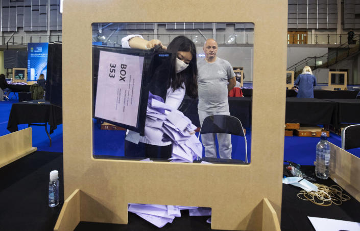 Votes are sorted to be counted for the Scottish Parliamentary Elections at the Emirates Arena,in Glasgow, Scotland, Saturday May 8, 2021. (Jane Barlow/PA via AP)
