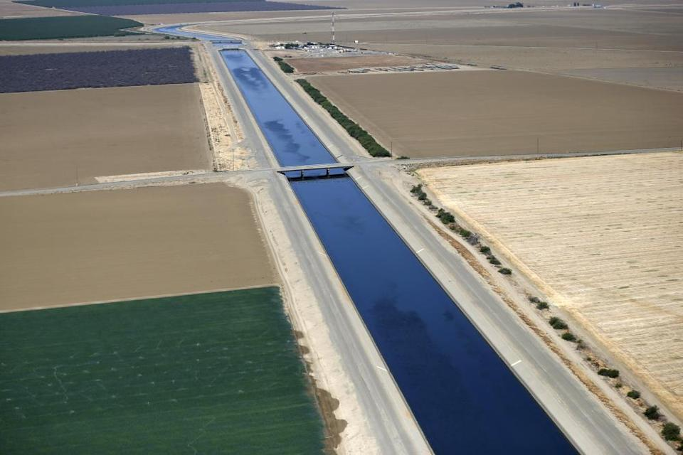 The California aqueduct and farm fields are seen in the Central Valley. The agriculture industry uses the vast majority of California's water.