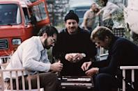 <p>Producer and screenwriter Michael G. Wilson plays backgammon with Israeli actor Chaim Topol and Roger Moore on the set of For Your Eyes Only.</p>