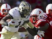 Purdue running back Akeem Hunt (1) runs away from Nebraska defensive end Greg McMullen, right, in the first half of an NCAA college football game in Lincoln, Neb., Saturday, Nov. 1, 2014. (AP Photo/Nati Harnik)