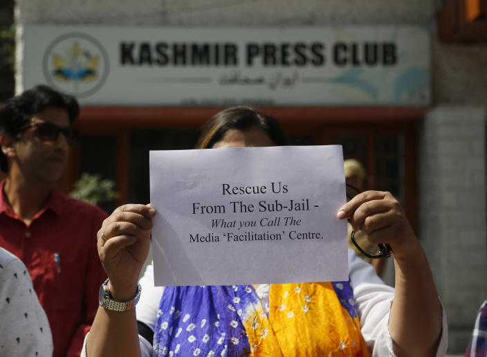 A Kashmiri journalists displays a placard during a protest against the communication blackout in Srinagar, Indian controlled Kashmir, Thursday, Oct. 3, 2019. For the last two months, mobile phones and internet services have been shut down in the valley after New Delhi stripped Indian-controlled Kashmir of its semi-autonomous powers and implemented a strict clampdown, snapping communications networks, landlines and mobile Internet. (AP Photo/Mukhtar Khan)