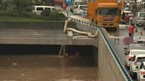 Flood aftermath: Water is pumped out of flooded tunnel in China