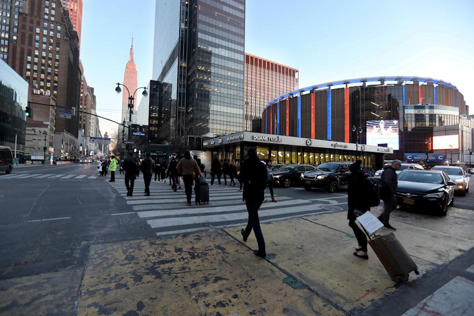 Pedestrians cross Eighth Ave. at 34st. in Manhattan Jan. 22, 2020. At right is Madison Square Garden, which includes Penn Station.
