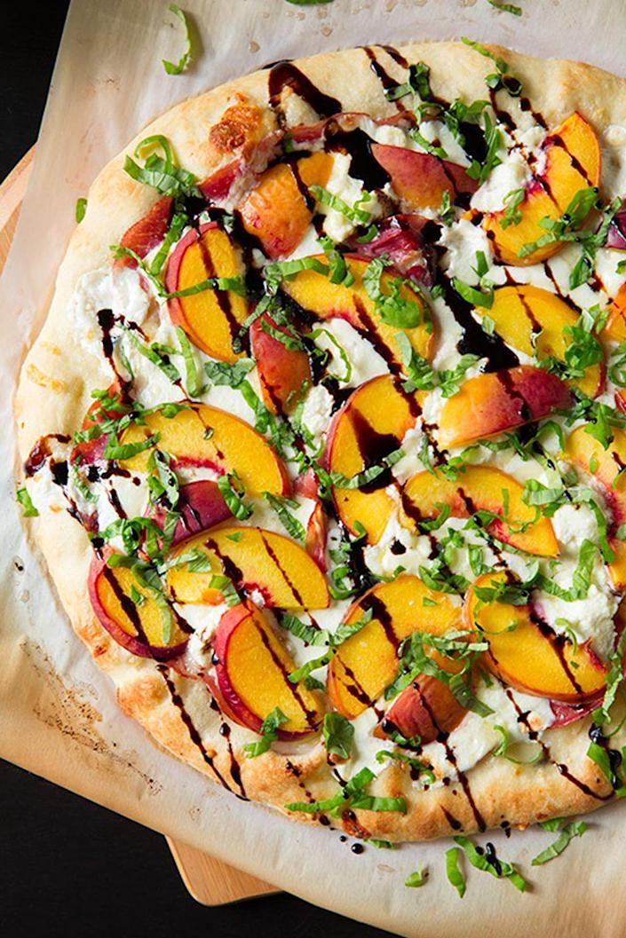 "<p>Great for a summer meal, this three cheese pizza is topped with peach, prosciutto, and basil. Don't forget to drizzle it with honey balsamic reduction! </p><p><strong>Get the recipe at <a href=""http://www.cookingclassy.com/three-cheese-peach-prosciutto-pizza-basil-honey-balsamic-reduction/"" rel=""nofollow noopener"" target=""_blank"" data-ylk=""slk:Cooking Classy"" class=""link rapid-noclick-resp"">Cooking Classy</a>. </strong></p>"