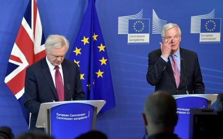 FILE PHOTO: The European Union's chief Brexit negotiator Michael Barnier welcomes Britain's Secretary of State for Exiting the European Union David Davis ahead of their first day of talks in Brussels