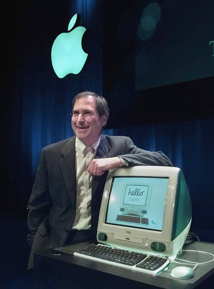 FILE - In this May 6, 1998, file photo, Steve Jobs of Apple Computers unveils the the new iMac computer in Cupertino, Calif. Apple on Wednesday, Oct. 5, 2011 said Jobs has died. He was 56. (AP Photo/Paul Sakuma, File)