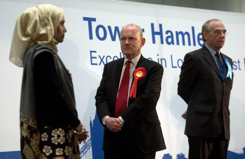 Labour's John Biggs is elected as the new mayor of Tower Hamlets as Independent candidate Rabina Khan (left) looks on after the count at the Excel Centre in London, to replace ousted mayor of Tower Hamlets Lutfur Rahman.