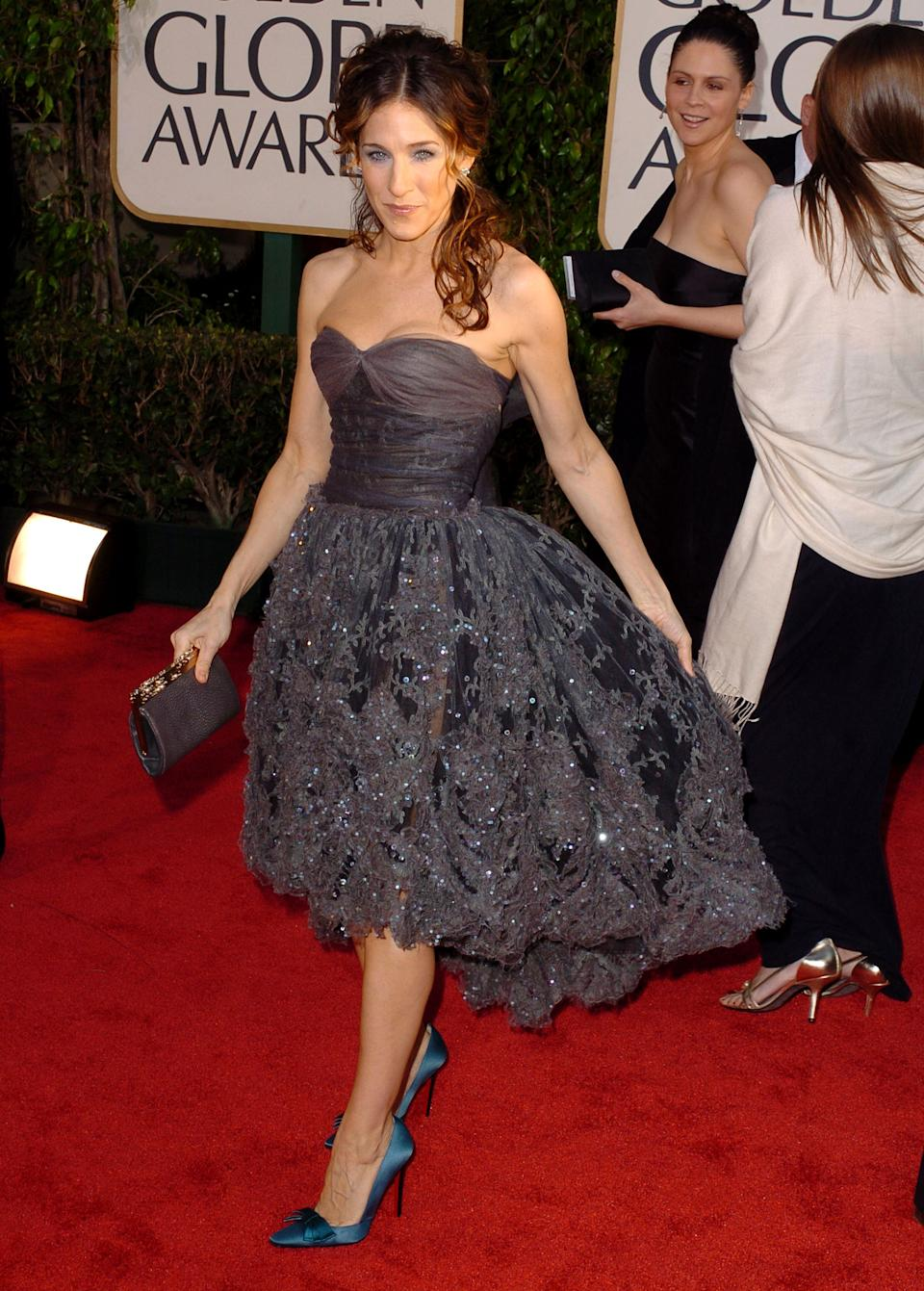 <p>It's because of dresses like this that we're so glad high-low hem trend is no longer in style. They should have never been. Thankfully, we can all learn from Sarah Jessica Parker and Chanel's mistake.</p>