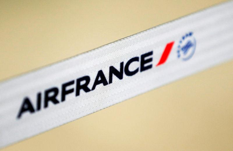 Air France logo is pictured at the Air France check-in at Bordeaux-Merignac airport, as Air France pilots, cabin and ground crews unions call for a strike over salaries in Merignac near Bordeaux