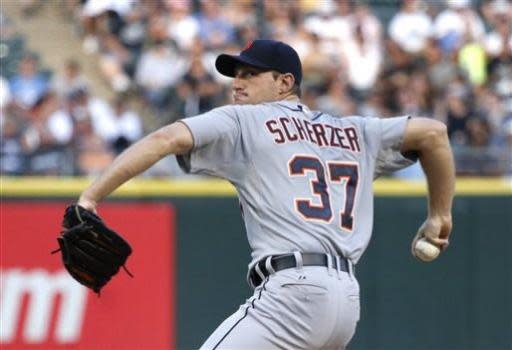 Detroit Tigers starting pitcher Max Scherzer delivers during the first inning of a baseball game against the Chicago White Sox Monday, July 22, 2013, in Chicago. (AP Photo/Charles Rex Arbogast)