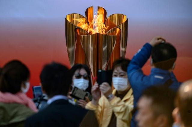 Organisers are under pressure to postpone the Tokyo 2020 Games because of the coronavirus pandemic (AFP Photo/Philip FONG)