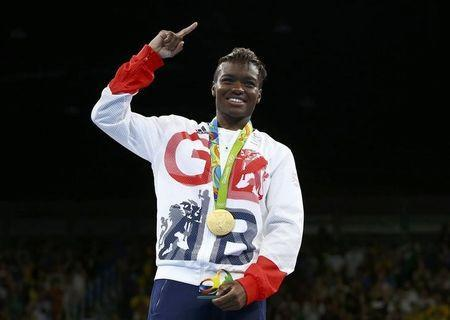 2016 Rio Olympics - Boxing - Victory Ceremony - Women's Fly (51kg) Victory Ceremony - Riocentro - Pavilion 6 - Rio de Janeiro, Brazil - 20/08/2016. Gold medallist Nicola Adams (GBR) of Britain poses with her medal. REUTERS/Peter Cziborra