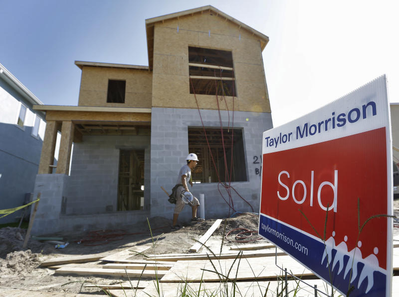"""FILE-In this Wednesday, Sept. 26, 2012, file photo, a """"sold"""" sign sits out in front of a home currently under construction at the Winthrop subdivision in Riverview, Fla. The U.S. economy is looking more resilient than many had thought, thanks in part to rising auto sales and another year-over-year surge in home prices on Tuesday, Oct. 2, 2012. (AP Photo/Chris O'Meara)"""
