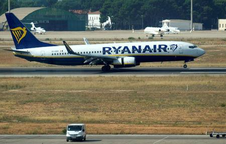 FILE PHOTO: A Ryanair Boeing 737 plane lands at the airport, during a protest on the second and last day of a cabin crew strike held in several European countries, in Valencia