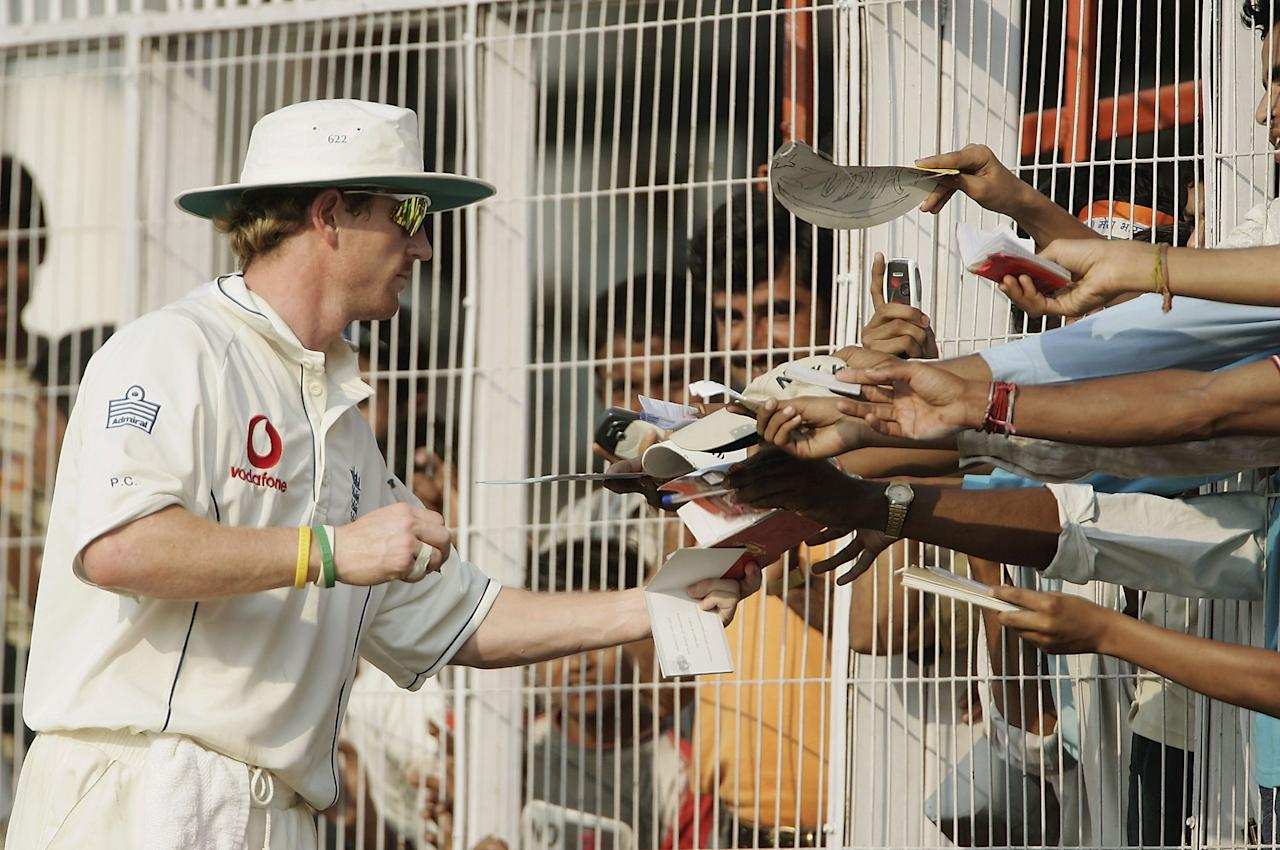 NAGPUR, INDIA - MARCH 03:   Paul Collingwood of England signs autographs during day three of the First Test between India and England at the VCA Stadium on March 3, 2006 in Nagpur, India.  (Photo by Tom Shaw/Getty Images)