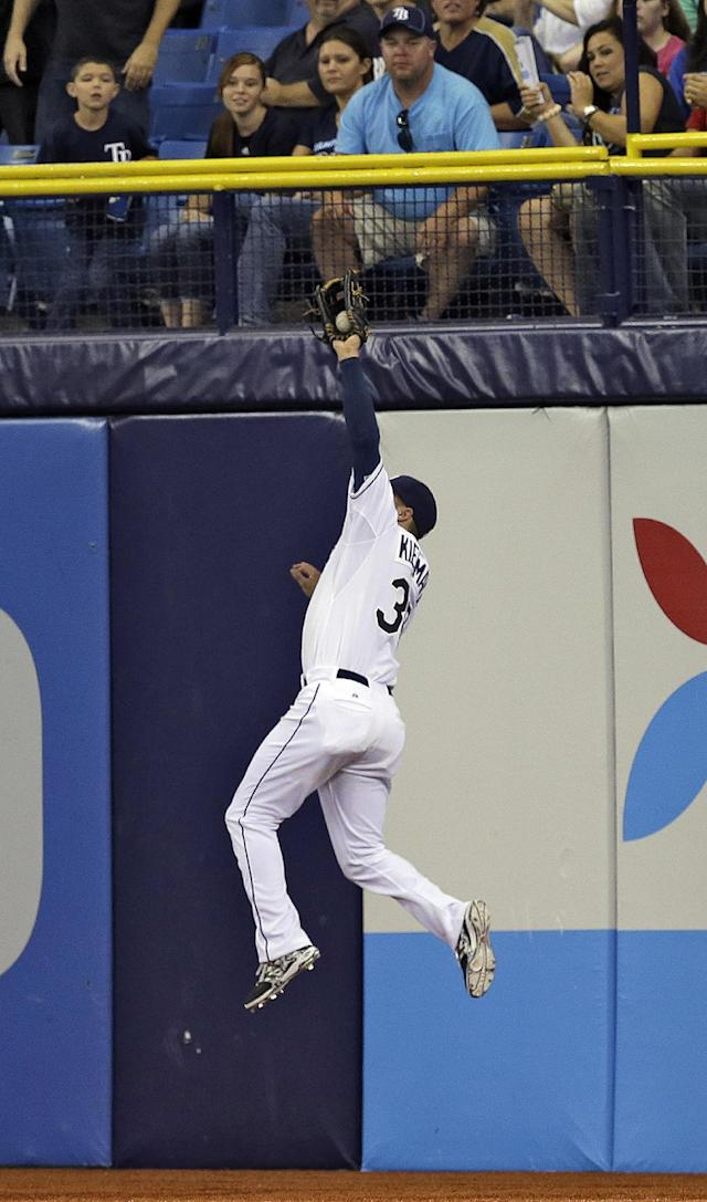 Tampa Bay Rays right fielder Kevin Kiermaier leaps high in the air to rob Milwaukee Brewers' Mark Reynolds of an extra base hit during the fifth inning of an interleague baseball game Monday, July 28, 2014, in St. Petersburg, Fla. (AP Photo/Chris O'Meara)