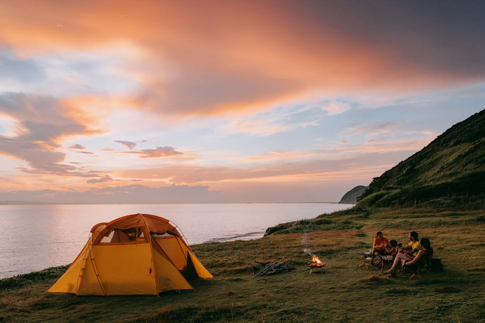 Family camping by the sea with dramatic sky at sunset, Chiba, Japan