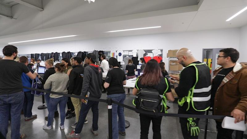 Tesla employees at the company's Nevada Gigafactory line up to buy discounted company merchandise in March 2019.