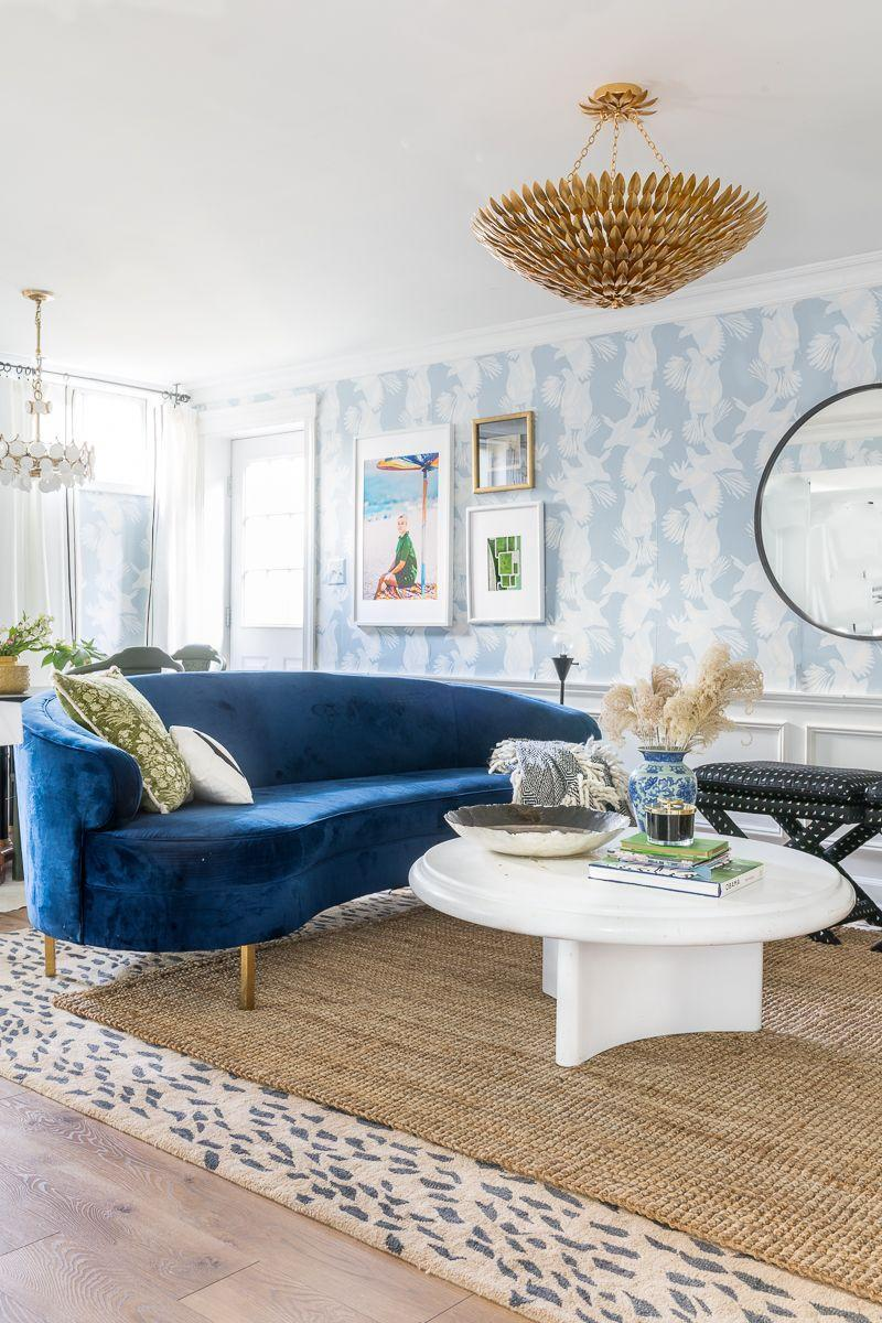 """<p>A curvy blue velvet sofa and an antique gold chandelier set a glamorous tone for this stunning basement sitting room. Adorn your walls with colorful vintage prints for added retro appeal. </p><p><strong>See more at <a href=""""https://jeweledinteriors.com/2020/02/basement-ideas/"""" rel=""""nofollow noopener"""" target=""""_blank"""" data-ylk=""""slk:Jeweled Interiors"""" class=""""link rapid-noclick-resp"""">Jeweled Interiors</a>.</strong></p><p><a class=""""link rapid-noclick-resp"""" href=""""https://go.redirectingat.com?id=74968X1596630&url=https%3A%2F%2Fwww.walmart.com%2Fip%2FVickerman-H2PPS000-6-46-in-Natural-Pampas-Grass-Assortment%2F920796993&sref=https%3A%2F%2Fwww.redbookmag.com%2Fhome%2Fg36061437%2Fbasement-ideas%2F"""" rel=""""nofollow noopener"""" target=""""_blank"""" data-ylk=""""slk:SHOP PAMPAS GRASS"""">SHOP PAMPAS GRASS</a></p>"""