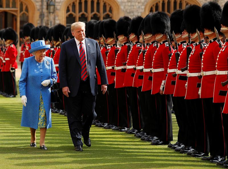 President Donald Trump and Britain's Queen Elizabeth inspect the Coldstream Guards during a visit Friday to Windsor Castle. (Kevin Lamarque / Reuters)