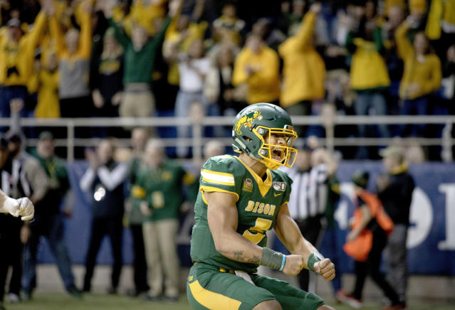 North Dakota State quarterback Trey Lance (5) celebrates his rushing touchdown during the first half of an FCS playoff NCAA college football game against Montana State, Saturday, Dec. 21, 2019, in Fargo, N.D. (AP Photo/Bruce Crummy)