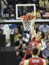 VMI forward Tyler Creammer (25) goes for the dunk against Wofford in the first half of an NCAA college basketball game for the Southern Conference tournament championship, Saturday, March 9, 2018, in Asheville, N.C. (AP Photo/Kathy Kmonicek